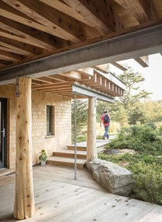 "An Artist Builds a Wooden Home That Lets Nature Be the Boss - Photo 4 of 7 - Angled beams are a fixture of the structure, both inside and out. The beams ""are an expression of the design, so they're reinforcing view lines,"" Winkelman says, ""but they're also weaving together the different axes of the site."""