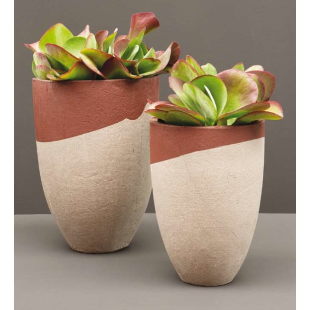 Berlin-based Atelier Hors-Serie's AT collection comes in natural or contrasting engobe finishes, which give the planters unique color combinations. From $63