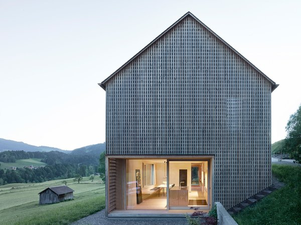 The lattice shell was hewn from silver fir sourced from a nearby forest. Eternit shingles clad the roof. Photo  of House For Julia Björn modern home