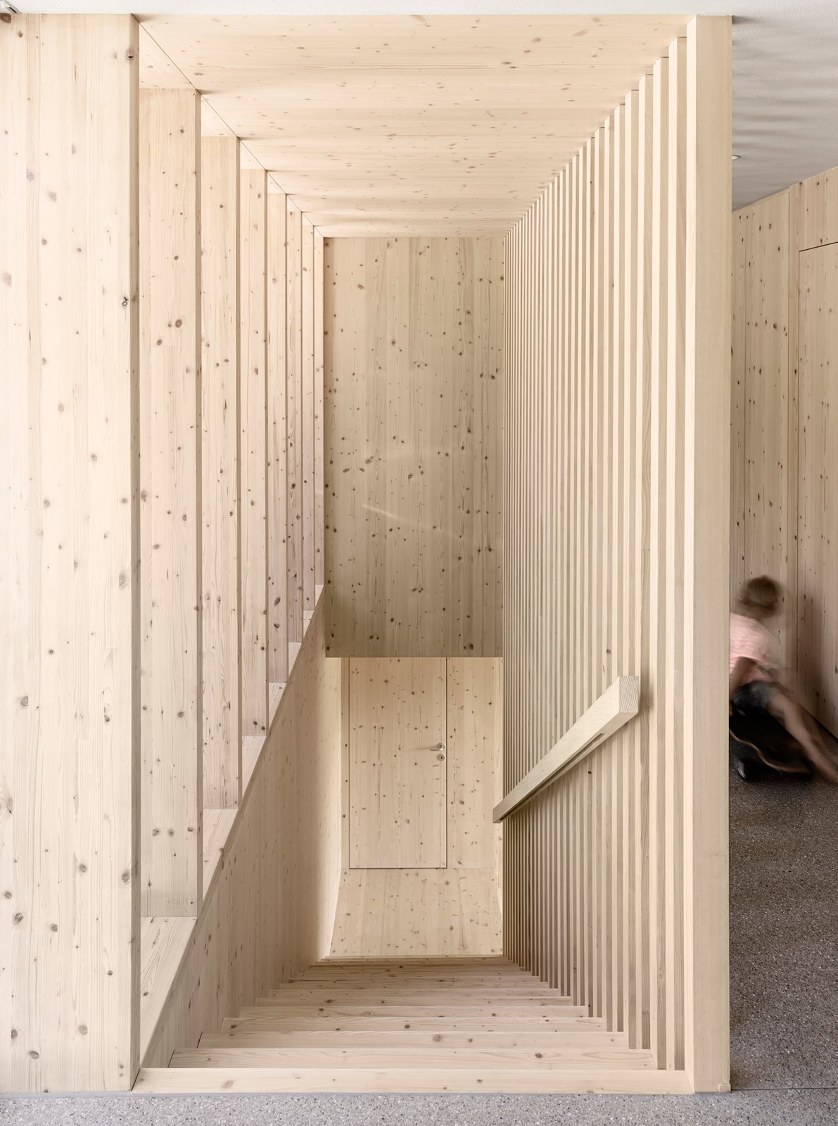 An unadorned spruce wood staircase leads to the upper level. Tagged: Staircase and Wood Tread.  Photo 6 of 10 in A Simple Gabled House Features an Intricate Latticework Shell from House For Julia Björn