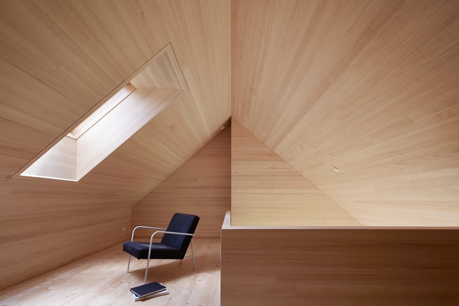 A skylight floods the loft space with daylight and offers views of the stars at night. Tagged: Windows, Skylight Window Type, and Wood.  Photo 7 of 10 in A Simple Gabled House Features an Intricate Latticework Shell from House For Julia Björn