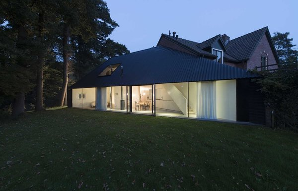 At night, residents can draw the curtains closed for privacy. Photo 8 of Triangular House modern home