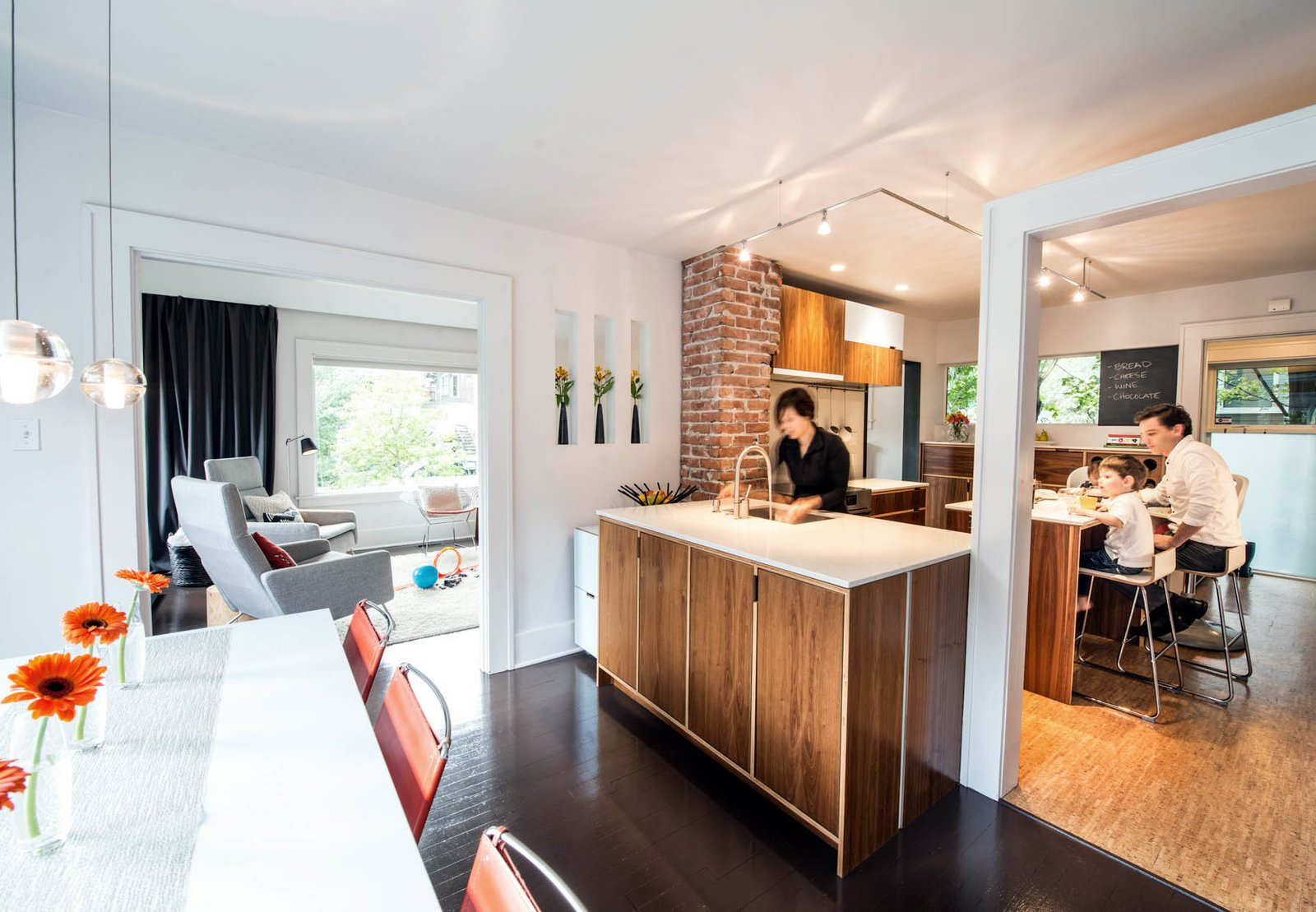Architects Sara and Jeremy Imhoff and their son Jonah use the renovated kitchen in their 1918 bungalow in Seattle's Fremont neighborhood.