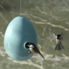 The ceramic design of this birdhouse will keep the sparrows out, yet create a welcoming home for smaller birds like wrens and chickadees. Photo  of 13 Great Modern Birdhouses modern home