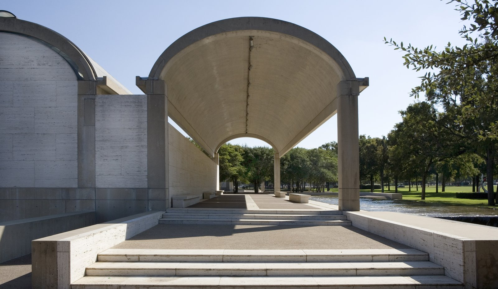 Kimbell Art Museum (Fort Worth, Texas: 1972)  Recalling the arched construction of Roman architects, Kahn's tubular museum design utilizes a row of cycloid barrel vaults, lined with reflective skylights that funnel natural light into the lengthy galleries.  Photo 2 of 10 in Design Icon: 9 Buildings by Louis Kahn