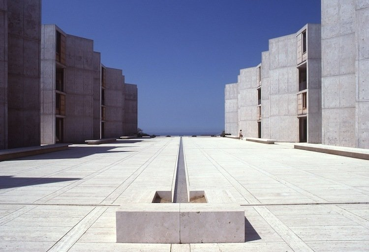 Salk Institute (La Jolla, California: 1965)  Inspired by medieval monasteries, Kahn's masterful example of symmetry reinforces Jonas Salk's initial instinct; he famously met with the architect for consultative purposes but their conversation so impressed Salk that he knew he had found the right architect. The two rows of buildings are like curtains framing the ocean, and a simple dividing line offers as much serenity and contemplation as the horizon rising above the sea.  Photo 5 of 10 in Design Icon: 9 Buildings by Louis Kahn