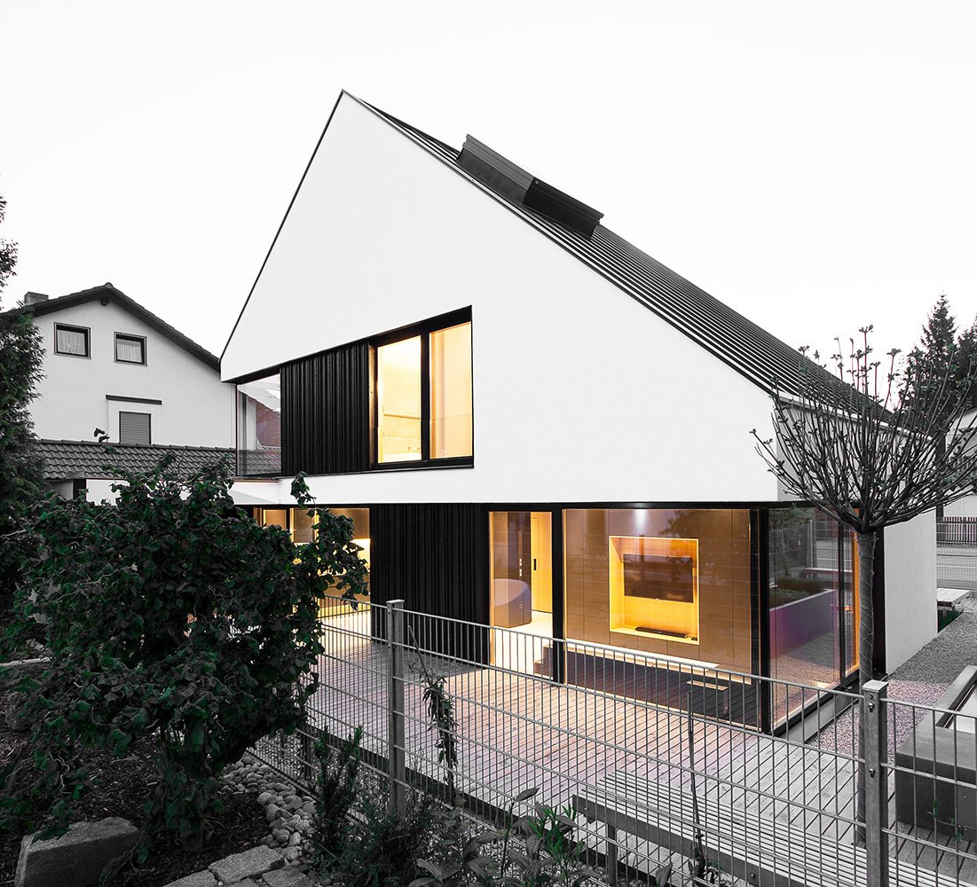 Sky-high ceilings are created by a sculptural pitched roof. Its uneven angles are the result of the required setback distances from surrounding roads and houses. A Strikingly Minimal Home Built in Less Than Six Months by Tiffany Jow