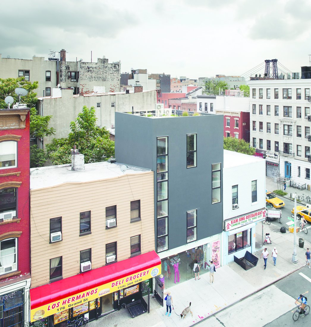 First things first: What's a Passive House? They're well insulated, virtually airtight buildings who must meet strict energy efficiency requirements. The benefit is that building passive can decrease home heating consumption by an astounding 90% and decrease overall energy consumption up to 75%. Here, a mixed-use building in Williamsburg, Brooklyn, with a single-family home atop a retail space, all designed by Loadingdock5. Photo by: Raimund Koch.