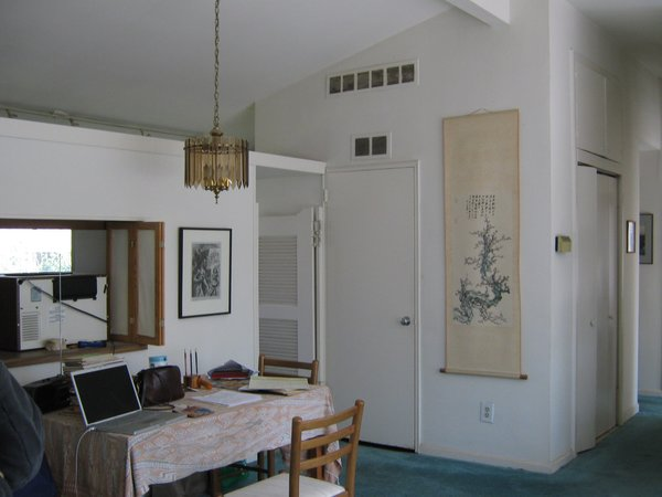 Here's another before look at the kitchen and dining space. What's most amazing is that Bloomberg didn't move any rooms or alter the footprint of the house during her renovation. She merely modernized the existing layout and refreshed the furniture and fixtures.