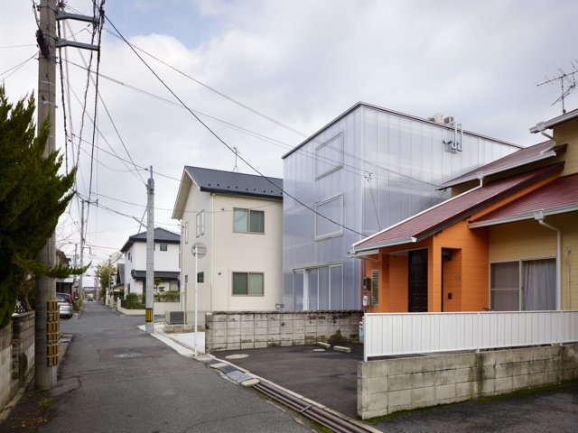 The milky-white, one-and-a-half-inch thick polycarbonate plastic panels keep its inhabitants from being seen from the outside (unless they stand right up against the wall). From inside, urban surroundings become a pleasantly blurry backdrop.  Japanese Homes by Dwell from The Home That Glows in the Dark