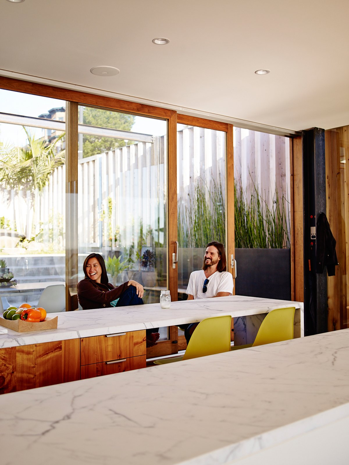Architect Craig Steely has become fast friends with Russell-Clarke and Moolsintong. He hangs out in the kitchen and lives not far from the house.  Photo 17 of 17 in Striking Slatted Wood and Glass Home in San Francisco