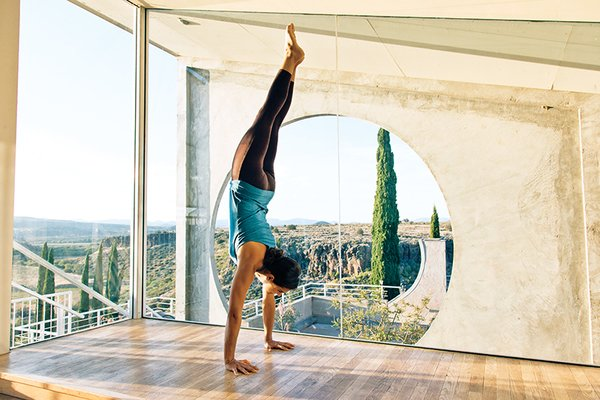 Arcosanti is also home to a small number of artists and people passing through. Halley Anderson worked at Arcosanti in 2012 and does a handstand in the Sky Suite, one of the rooms available for rent.<br><br>Photo by: Peter Bohler