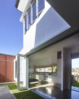 5 Sustainable Ways To Beat the Heat Without Air Conditioning - Photo 4 of 11 - By opening doors and windows on opposite sides of the house and on upper and lower floors, air can easily circulate through this home.