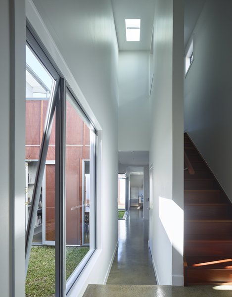 Polished concrete covers the ground level. Photo 6 of Annie Street modern home
