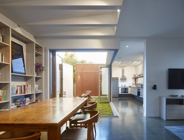 """The outlook from the kitchen and main house entry is directly into the two northern facing courtyards,"" O'Neill said. A refrigerator by Fisher & Paykel stands in the kitchen next to a QASAIR Heritage range hood. Photo 7 of Annie Street modern home"