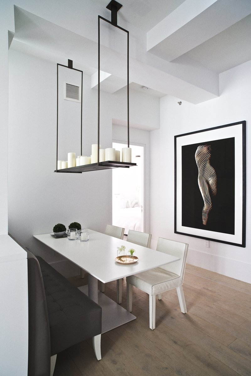 """Piet Boon designed the leather banquette shown here specifically for his Huys project. For more on Boon's furniture design, visit the first-floor gallery at 404 Park Avenue South. The ceilings are 11'5"""" tall and feature original beams that have been painted over in a cool white."""