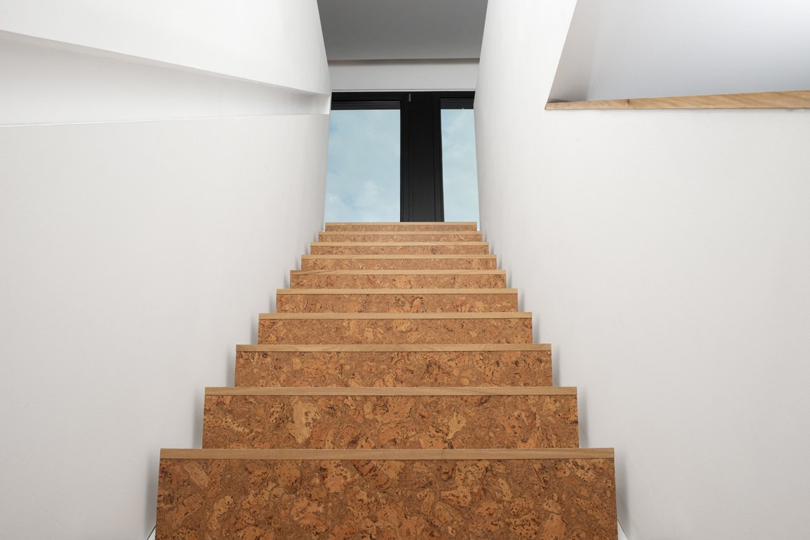 Cork staircases connect each floor of the house, while adding warmth and texture to the home's neutral palette.  190+ Best Modern Staircase Ideas by Dwell from Ferrum House