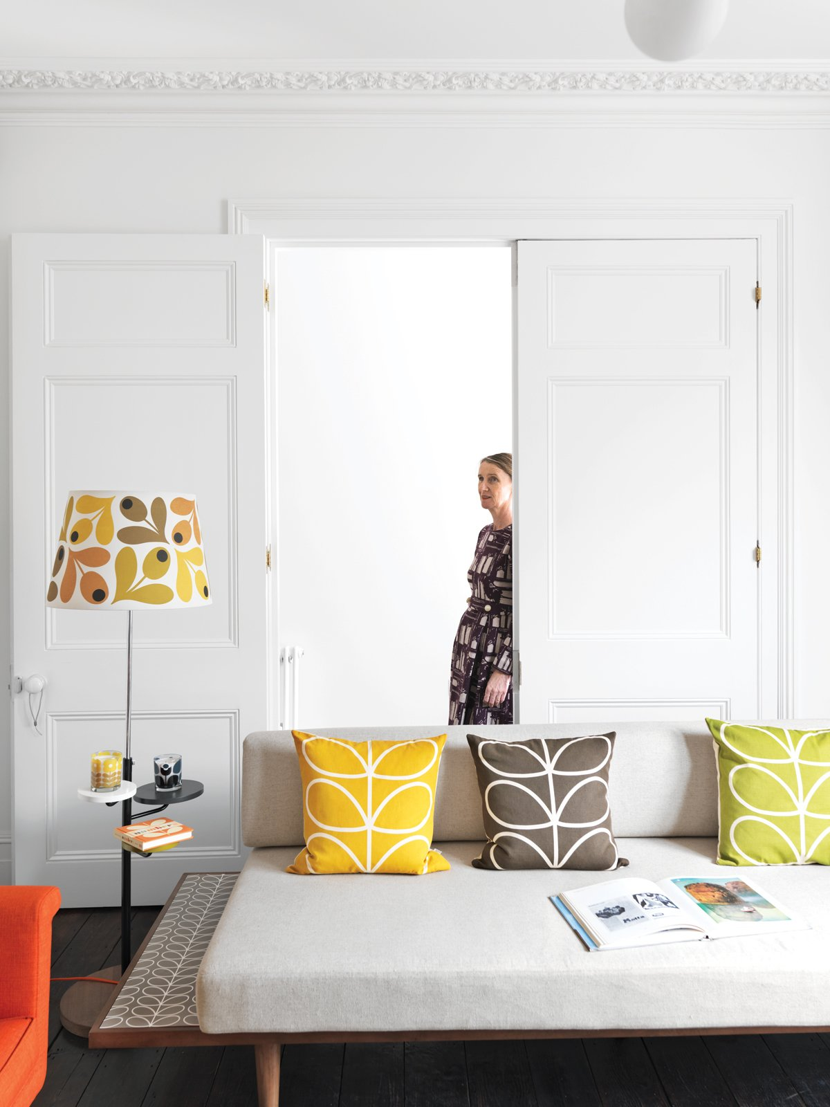 Textile designer Orla Kiely's renovated London Terrace House is punctuated by her distinctive palette and motifs. Tagged: Living Room, Sofa, and Dark Hardwood Floor.  Photo 1 of 5 in A Textile Designer's Home Is Unapologetically Colorful