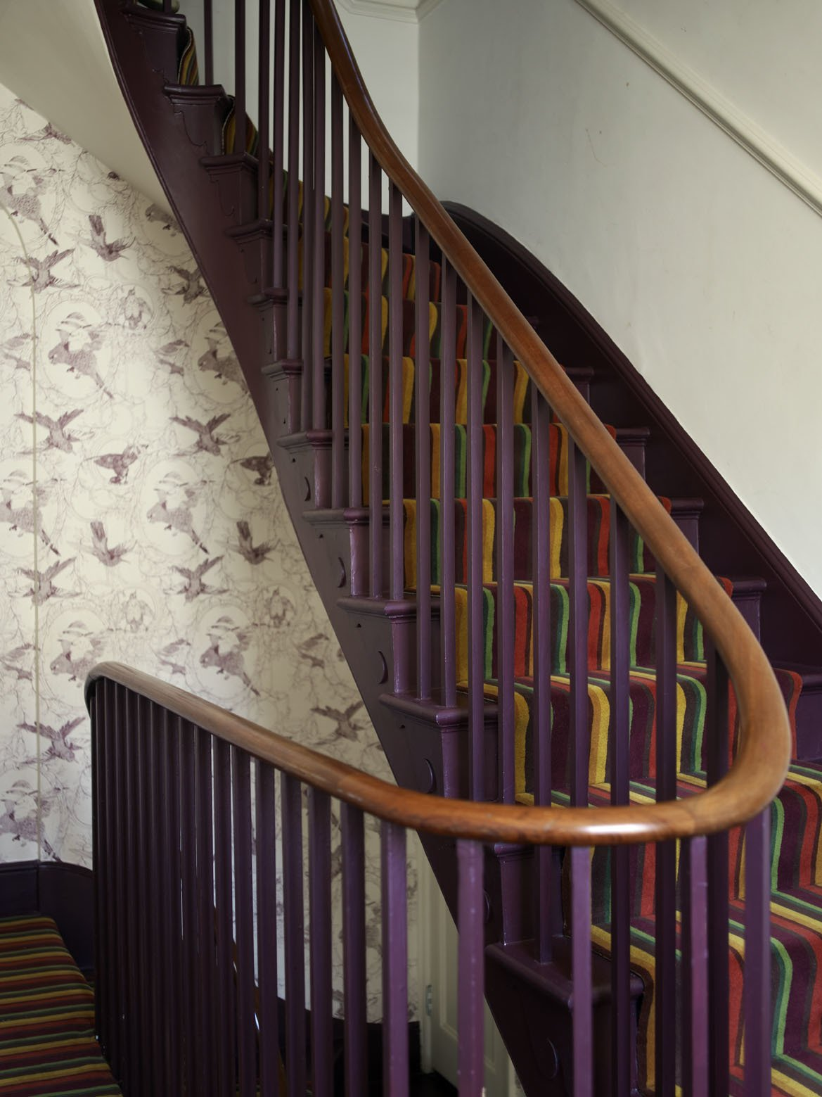 A new, wider staircase replaced the original Victorian version, and links the public and living areas; and the kitchen and the subterranean basement office.  Much of the salvaged materials in the house came from the National Museum of Scotland, and their zoological origins have been picked up in the wallpaper created by Danile Heath, which features drawings of birds being stuffed for display. A Gracious London Terrace House Is Reborn with Salvaged Materials - Photo 5 of 12