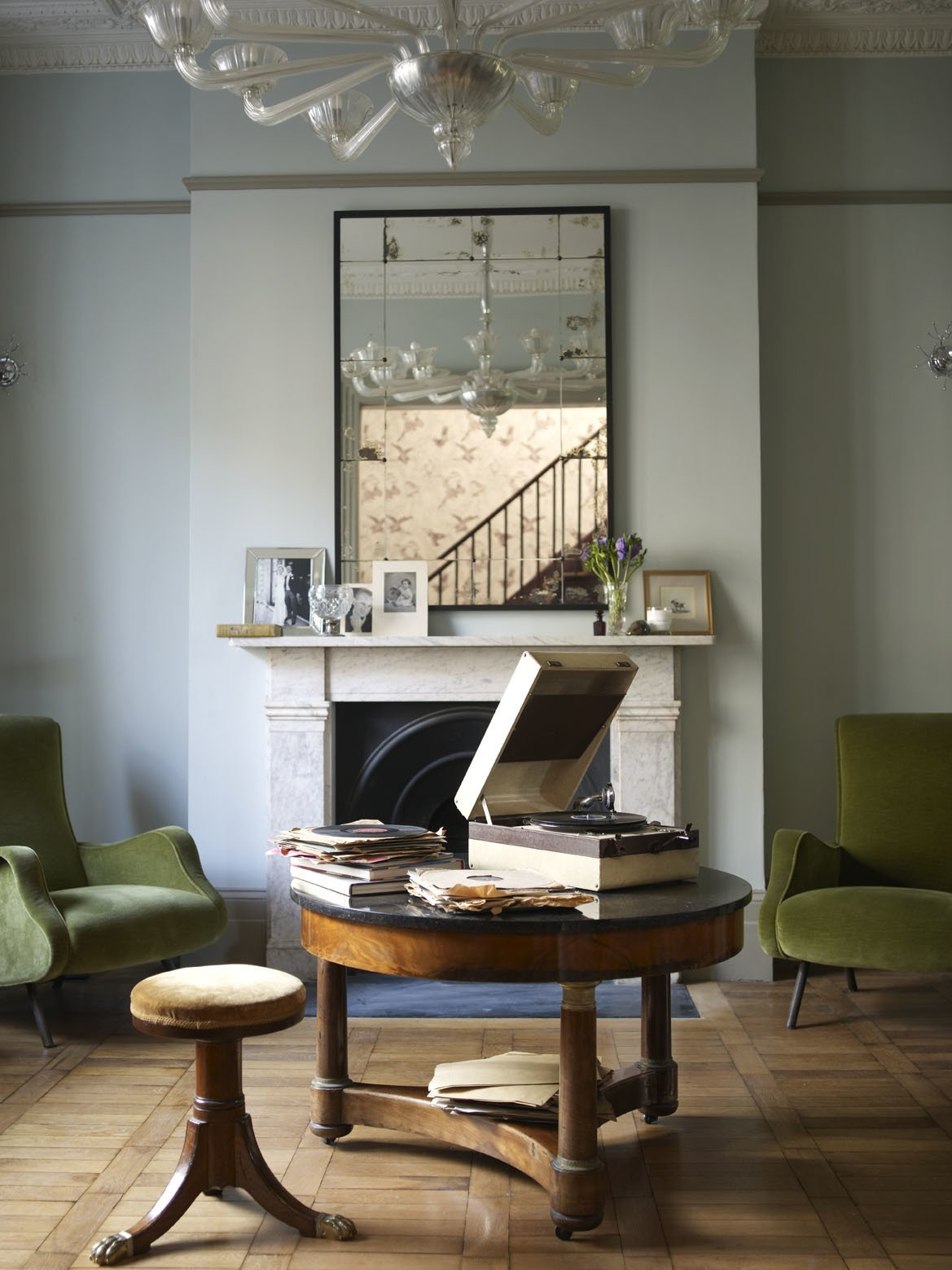 Leading directly off the entrance hall, this simple but elegant sitting room was originally the kitchen. The room has been redesigned for entertaining, and revolves around a 1946 Decca gramophone on which the owner plays his collection of 78s at cocktail parties.  Photo 6 of 12 in A Gracious London Terrace House Is Reborn with Salvaged Materials