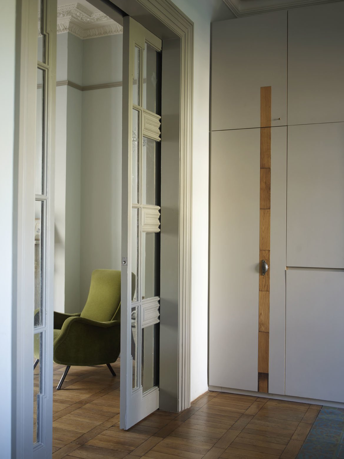 The doorways were widened to improve spatial flow. Sliding pocket doors from a 1950s French hotel were installed, and now feed into the living areas.