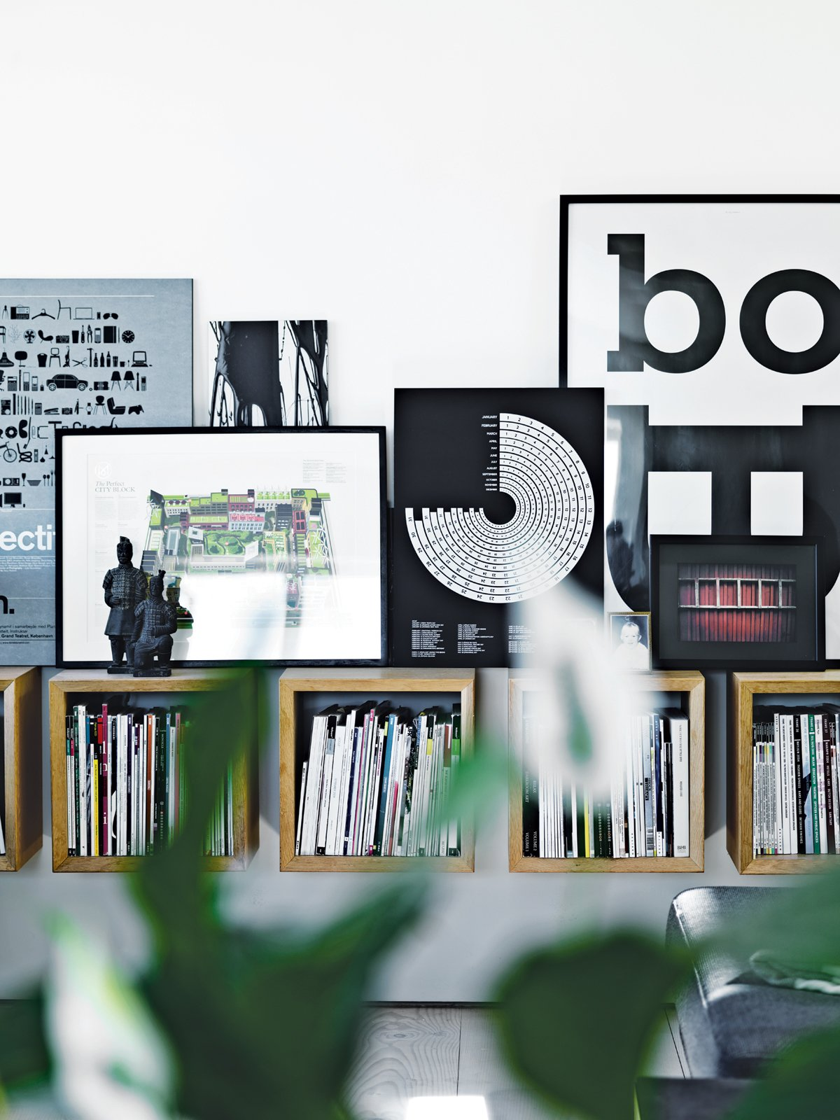 In the main living area, Olsen's own artwork picks up on the graphic diversity of the magazines housed in Boox shelving by Jesper Holm.  Modern Danish Homes We Love by Aileen Kwun from Converted Loft Fit for a Modern Family in Copenhagen