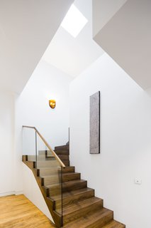 Renovation: A Breezy Modern Addition Opens Up a Historic Melbourne Home - Photo 6 of 7 - Here, the hardy oak stairs contrast with the clean white walls.