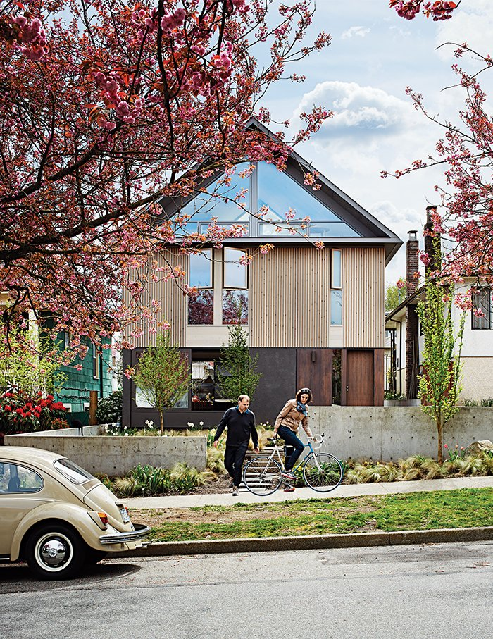"Stephen Waddell and Isabel Kunigk worked with architect D'Arcy Jones to breathe new life into their ""dank old"" structure. The couple chose to sacrifice square footage inside in order to make the most of outdoor space. Tagged: Exterior, House, Wood Siding Material, Metal Siding Material, Glass Siding Material, and Gable RoofLine.  Modern Spaces in the Pacific Northwest by William Lamb from This Bungalow is Anything but Basic"