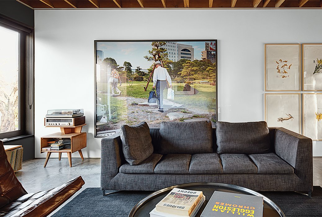 In the living area, a Ligne Roset sofa accompanies a vintage Adolf Loos coffee table. The 2003 photograph Pond Garden is by Stephen Waddell. Tagged: Living Room and Sofa.  Modern Spaces in the Pacific Northwest by William Lamb from This Bungalow is Anything but Basic