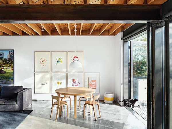 An Alvar Aalto table is surrounded by a quartet of the designer's Chair 65.