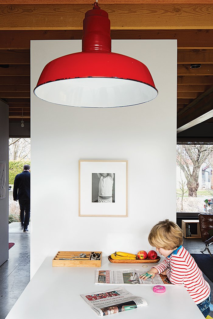 The pendant lamp is a vintage find. Tagged: Kitchen and Pendant Lighting.  Photo 6 of 11 in This Bungalow is Anything but Basic