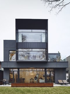 On a Peaceful Wooded Lot, a Futuristic Toronto Home is Buzzing with Smart Tech - Photo 1 of 10 - When the Casali family gave Michael Krus and Prishram Jain of TACT Architecture free rein to work with unconventional materials, the architects responded by creating a geometric 4,300-square-foot smart home encased in aluminum panels by Agway Metals.