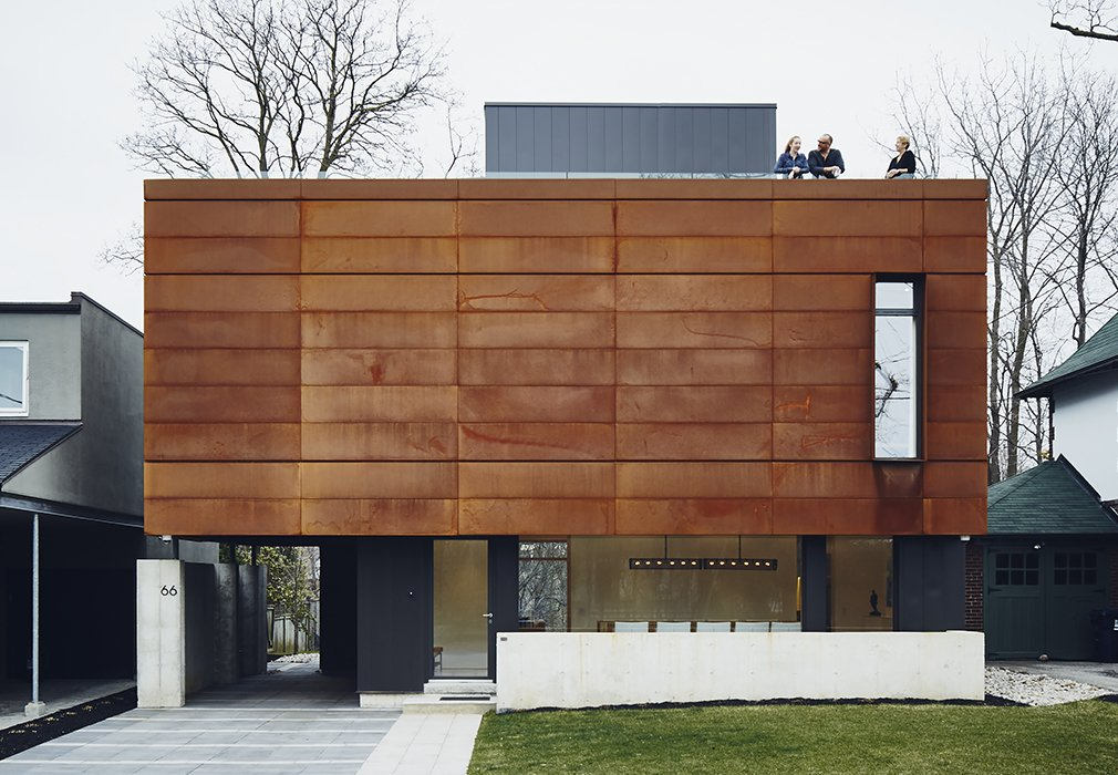 The front facade features Cor-Ten steel fabricated by Praxy Cladding.  Photo 2 of 10 in On a Peaceful Wooded Lot, a Futuristic Toronto Home is Buzzing with Smart Tech