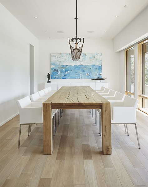 The floors are gray-stained white oak, and the dining room table is from Restoration Hardware.