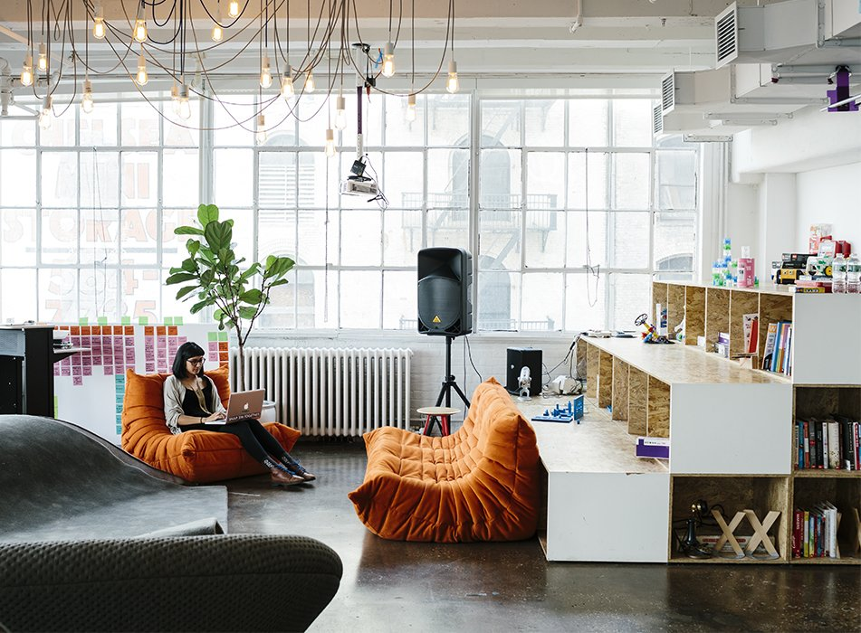 New York firm MCDC designed littleBits's Chelsea office, which is outfitted with Togo sofas from Ligne Roset and an overhead fixture by Tech Lighting. The shelves hold books and play materials like Legos and K'nex. Tagged: Living Room, Sofa, and Pendant Lighting.  Best Photos from DIY Electronics Company Aims to Turn Even the Least Savvy Users Into Smart Tech Wizards