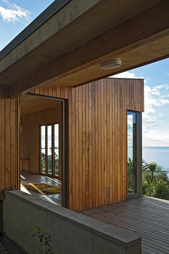 The architects drew upon their own experiences vacationing in baches to develop the design. Approximately 1,000 square feet of interior spaces are connected by 270 square feet of deck—a healthy ratio for indoor-outdoor living.  Photo 2 of 3 in Almost Every Part of this Prefab Beach House Was Brought to its Secluded Site by Hand