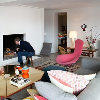 A Cheerful and Modern Living Room in Belgium - Photo 1 of 2 - Renaud de Poorter lights a fire in his Bellum, Belgium, residence.