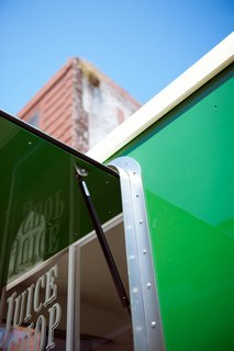 Freshly Squeezed: Mobile Juice Truck Makes Its Debut - Photo 5 of 9 - Detail of gas shock that assist in the opening of window/awning.<br><br>Photo by: Meg Haywood-Sullivan