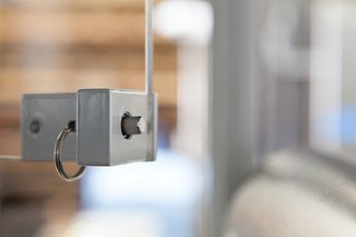Detail of custom latch for the windows inside service window.<br><br>Photo by: Markio Reed