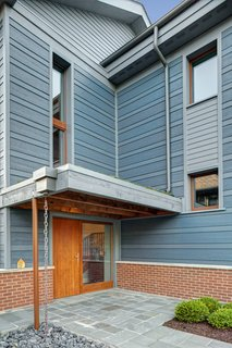 Sustainable Living: Chicago's First Certified Passive House - Photo 2 of 8 - The entry sequence was designed to allow accessible entry, creating a sense of shelter and highlighting the thickness of the super-insulated ICF walls.