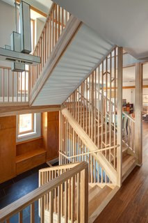 The American Yellow Birch-clad staircase was designed as a screen inspired by light filtering through a forest.<br><br>Photo by: Eric Hausman Photography
