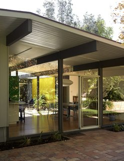 What Are Eichler Homes and Why Do People Love Them? - Photo 6 of 8 - This Fairhaven tract Eichler home built in 1961 in Orange, California, by architects A. Quincy Jones and Frederick E. Emmons features walls of glass.
