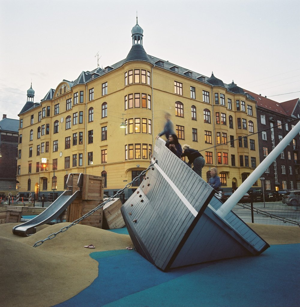 The wrecked coaster Trinidad on Søndre Boulevard in Copenhagen is a playground meant for younger children and is therefore kept close to the ground and with focus on balancing games and speed paths. It lies at exactly the same spot where the beach was in the 19th century.  Photo 1 of 8 in Imaginative Playgrounds by Monstrum