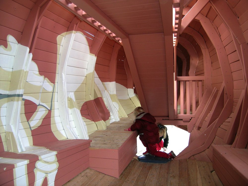 On the inside, the whale is decorated with drawings of the internal organs and a whale foetus. On one side of the whale there is a large opening where you can see whale's white ribs, shaped like something in between ribs and the frame timber on a submarine.  Photo 6 of 8 in Imaginative Playgrounds by Monstrum