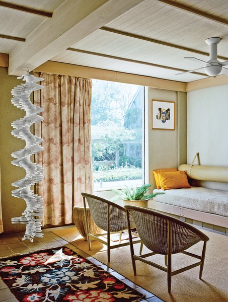 The ground-floor guest room sports built-in beds and a hanging sculpture by Robert Clark.