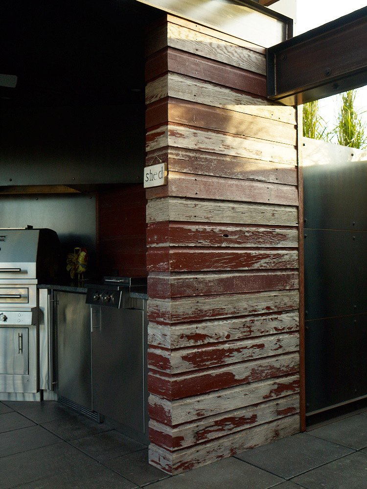 Burgum opted for locally sourced reclaimed wood from a demolished barn to build sections of the pergola covering the cookspace.  Photo by: David Bowman  Photo 5 of 6 in Green Planning in North Dakota