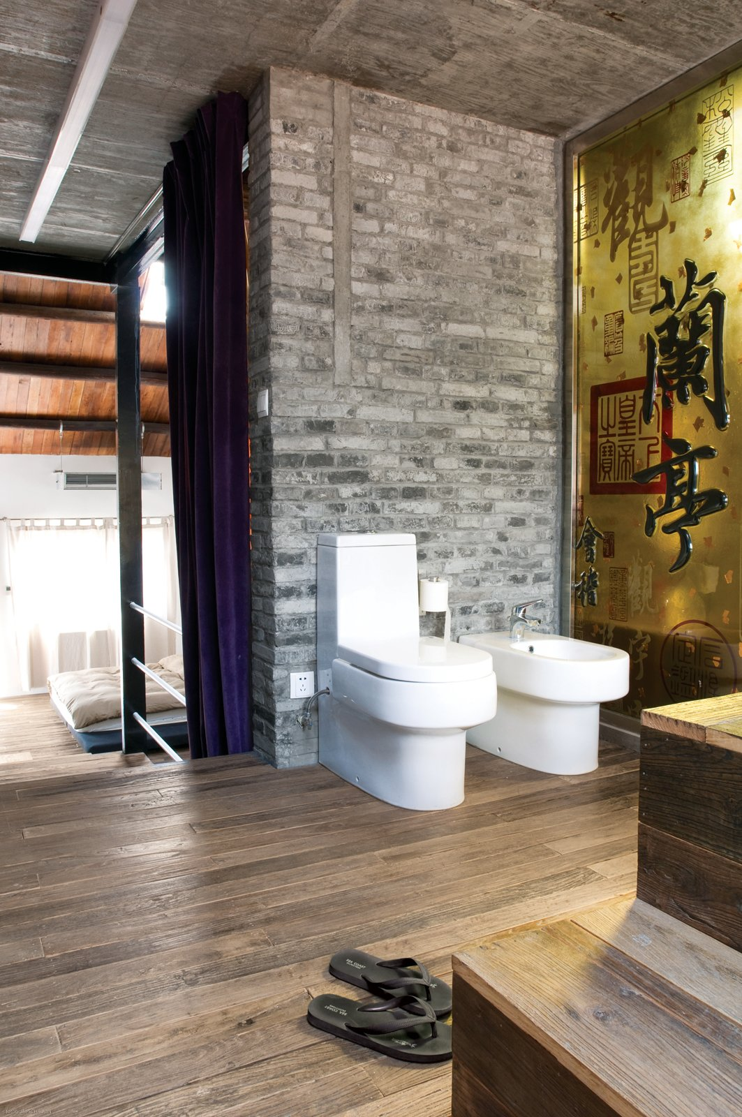 A yellow glass panel divides the shower from the toilet and the bidet.  Photo 9 of 11 in Modern Lilong House Renovation in Shanghai