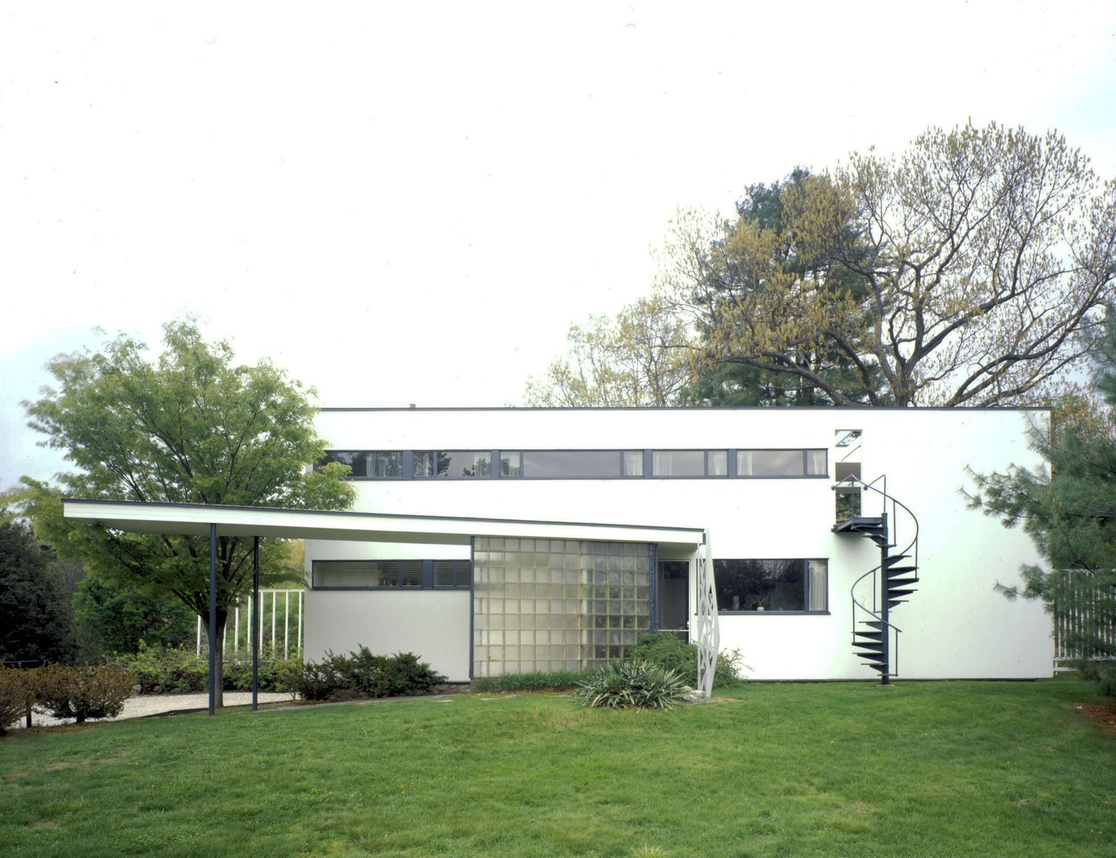 Gropius House, Walter Gropius, 1938, Lincoln, Massachusetts.  When Bauhaus founder Walter Gropius moved to the United States, he settled in Lincoln, Massachusetts, where he built his family home. The house is modest in scale yet revolutionary in impact, embodying the Bauhaus principles of simplicity, economy, and restrained beauty. It combines traditional elements of New England architecture—wood, brick, and fieldstone—with innovative materials rarely used in domestic settings at that time, including glass block, acoustic plaster, chrome banisters, and the latest technology in fixtures. The house is recognized as a National Historic Landmark for its influence in bringing international modernism to the United States. A Getty grant will support the development of a conservation management plan for the building and site, to ensure the preservation of its characteristic features for the home's continued use as a teaching tool to transmit the tenets of Bauhaus design. Grant support: $75,000  Midcentury Homes by Dwell from Iconic Modern Buildings That Will Be Saved with the Help of the Getty Foundation