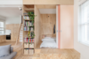 """The new floor plan maximizes social areas and minimizes sleeping spaces through the creation of """"micro"""" bedrooms that fit a single bed. The rooms were sectioned off with full-height, pine plywood joinery — a nod to Shigeru Ban's Furniture House. Sliding doors reminiscent of Japanese Shoji screens can be drawn closed for intimacy or opened to extend the visual space. Photo  of A Tiny Apartment Renovation for a Growing Family in Melbourne modern home"""