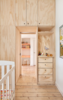 """The full-height cabinets offer plenty of nooks and crannies where household goods can be hidden away. """"Carefully considered storage provides space for each family member's essentials, yet limits consumption and places greater value on the objects that they have chosen to live with,"""" Cousins says. Photo  of A Tiny Apartment Renovation for a Growing Family in Melbourne modern home"""